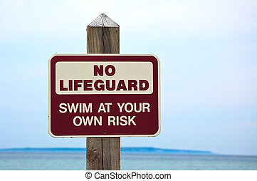 "No lifeguard on duty, sign - ""No lifeguard. Swim at your..."