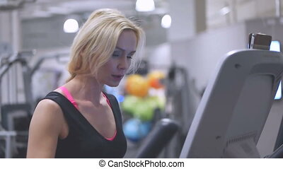 Young blond woman in a gym