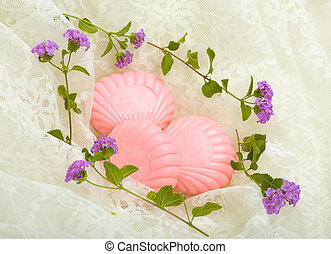 Herbal Soap Cradle - Pink herbal soap bars with flowers on...