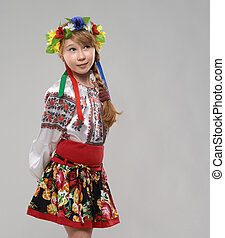 red-haired girl in Slavic national costume dreams - Pretty...