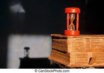 antique book and red broken sandglass hourglass - antique...