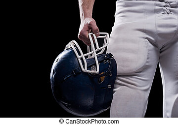Crash helmet Cropped image of American football player...