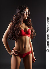 Tanned curly model advertises erotic underwear - Image of...