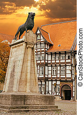 Lion statue and old timbered house in Braunschweig, Germany...
