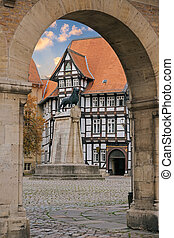 Lion statue and old timbered house in Braunschweig patio,...