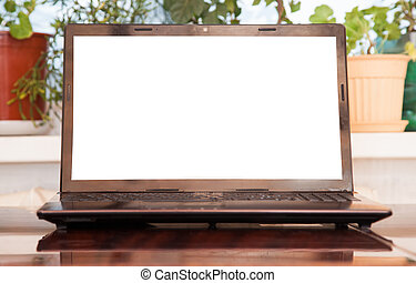 Open laptop with isolated screen on the wooden table....