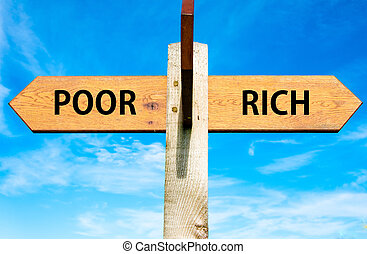 Poor versus Rich - Wooden signpost with two opposite arrows...