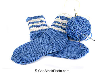 knitted socks from woolen thread and skein of thread on a...