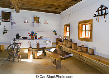 Ukrainian historical peasant dwelling interior with various...