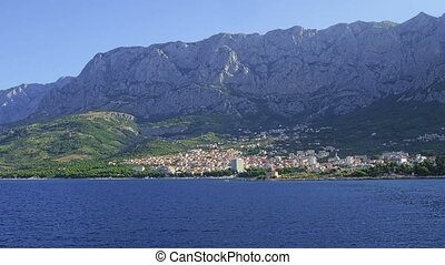 Makarska, Croatia - Beautiful city of Makarska shot from sea...