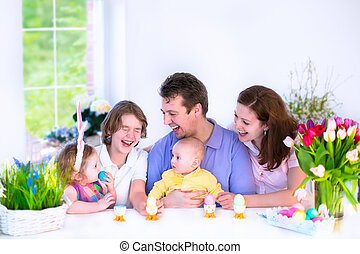 Family having breakfast on Easter day - Happy young family...