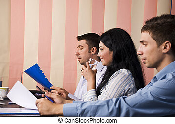 Business people at work - Businesswoman speaking and...
