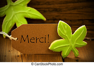 Brown Organic Label With French Text Merci On Wooden...