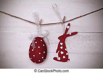One Red Easter Bunny And Easter Egg Hanging On Line With...