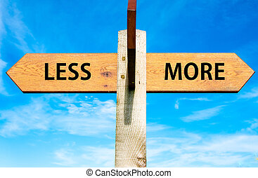 Less versus More - Wooden signpost with two opposite arrows...