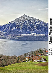 Niesen Mountain and lakeview near Thun lake in Swiss Alps in...