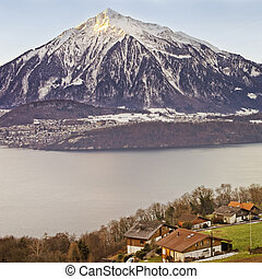 Panoramic view over Swiss Apls mountains near the Thun lake...