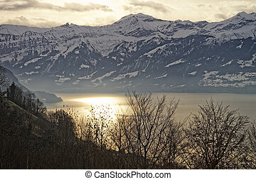Sunrise over the Thun lake in Swiss Alps in winter -...