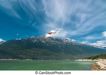 Helicopter flying out from Alaska - Red and silver...