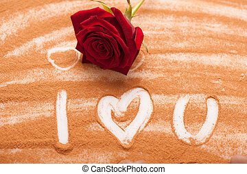 Romantic message written with chocolate powder - Love is so...