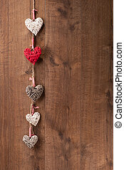 Hearts hanging on wooden wall - Love you. Closeup image of...