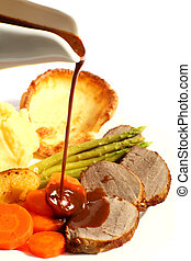 Roast beef and gravy - A meal of roast beef with carrots,...