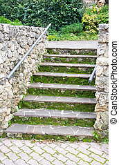 Rustic stone staircase with moss close up view