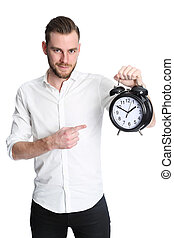Man pointing at clock - An attractive man wearing a white...
