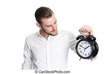 Looking at time - An attractive man wearing a white shirt...