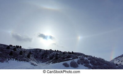 Large halo around the sun on a winter day in mountains...