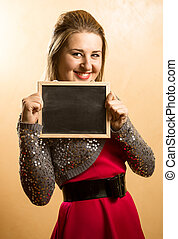photo of woman holding blackboard with copyspace