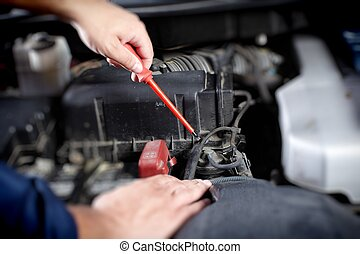 Mechanic working in auto repair garage Car maintenance