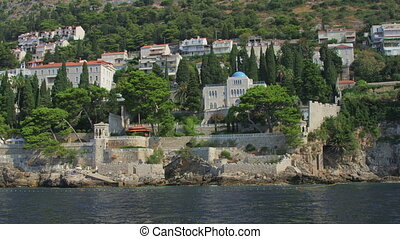 Dubrovnik old town surroundings with rocky beach. Shot from...