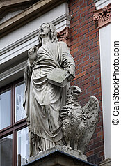 Saint John the Evangelist on the facade of Evangelical...
