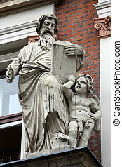 Saint Matthew the Evangelist on the facade of Evangelical...