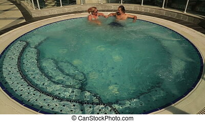 Couple in Spa - Happy couple relaxing together on a jacuzzi...