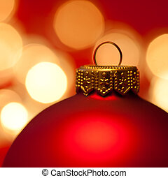 Christmas bauble - Red Christmas bauble with blured lights...