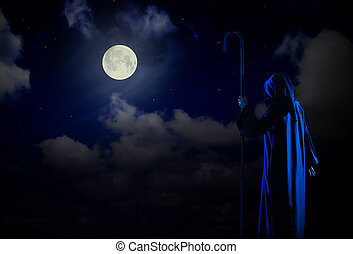 Silhouette of witch on night sky background