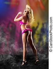 Go-go dancer at night club - Go-go dancer in red costume at...