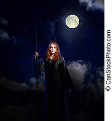 Witch on night sky background - Young witch on night sky...