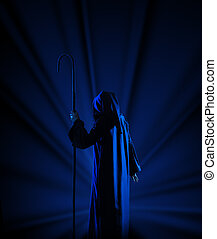 Silhouette of witch on blue rays background