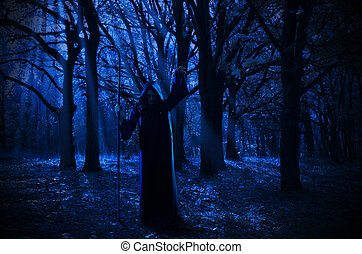 Witch in the night forest - Young witch in the night forest