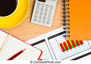business still life - image of a cup of coffee, calculator,...