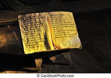 manuscript on wooden easel - open old manuscript on wooden...