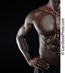 African muscular man body - Close-up shot of young african...