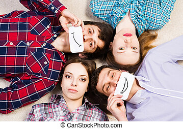 four young men lie together, applied to the face card with...
