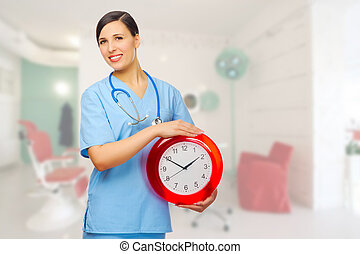 Smiling doctor with clock at medical office