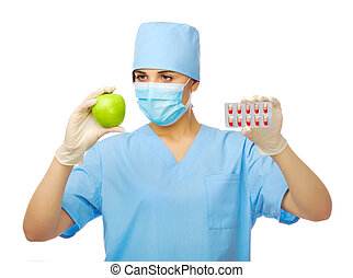 Young doctor with green apple and pills