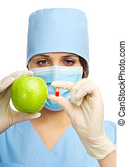 Doctor with green apple and pill