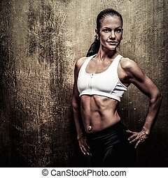 Beautiful athletic woman with dumbbells - Beautiful athletic...